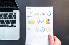 Person Holding Chart And Bar Graph Stock Photo