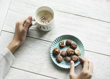 Person Holding Chocolates And White Ceramic Mug Stock Image