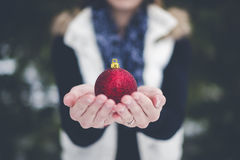 Person holding Christmas decoration Royalty Free Stock Photography