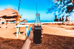 Person Holding Coca-cola Glass Bottle Royalty Free Stock Images