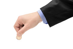 Person holding a coin Royalty Free Stock Photo