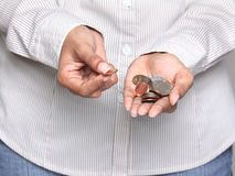 Person holding coins Stock Photos