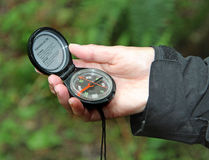 Person holding a Compass. Hiker holding a Compass in their Hand Royalty Free Stock Photo