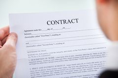 Person holding contract Royalty Free Stock Images