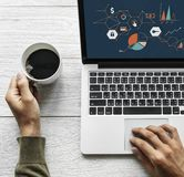 Person Holding Cup of Coffee Beside Gray Laptop Computer stock photography