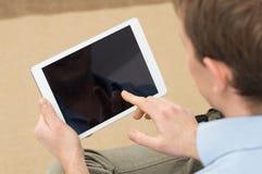 Person Holding Digital Tablet Arkivfoto