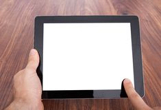 Person holding digital tablet Royalty Free Stock Images
