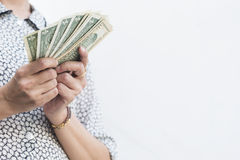 A person holding dollar money with two hands Royalty Free Stock Photos
