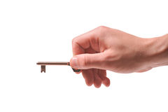 Person holding a door key Royalty Free Stock Images