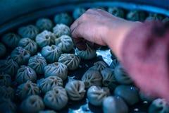 Person Holding Dumplings Stock Image