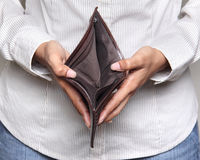 Person holding an empty wallet. Bankcruptcy - Business Person holding an empty wallet Stock Images