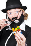 Person Holding Eyeglasses Showing Cube Puzzle Stock Photography