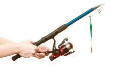 Person holding fishing rod, spinning equipment. Stock Images