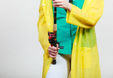 Person holding fishing rod, spinning equipment. Royalty Free Stock Photo
