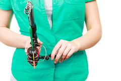 Person holding fishing rod, spinning equipment. Stock Image