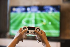 Person Holding Game Pads stock photo