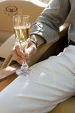 Person holding a glass of Champagne Royalty Free Stock Image