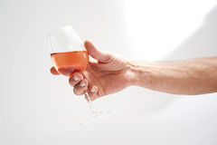 Person holding a glass of ros  wine Royalty Free Stock Image