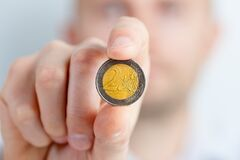 Person Holding a Gold and Silver Round Coin Royalty Free Stock Photo