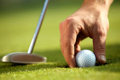 Person holding golf ball Royalty Free Stock Photography