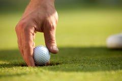 Person holding golf ball, close-up stock photos
