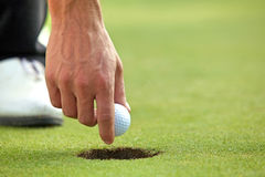 Person holding golf ball, close-up Royalty Free Stock Photography