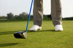 Person holding golf stick, low section Royalty Free Stock Images