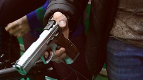 Person holding a gun in hand. Close-up. Firearms gun submachine sniper rifle large-caliber weapons close-up stock video