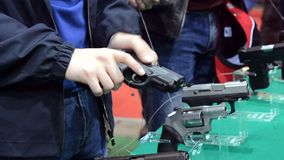 Person holding a gun in hand. Close-up. Firearms gun submachine sniper rifle large-caliber weapons close-up stock footage