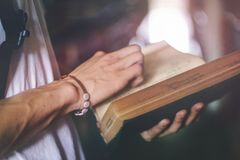 Person Holding Hardbound Book Royalty Free Stock Photography