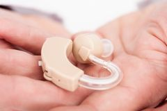 Person holding hearing aid Royalty Free Stock Photo