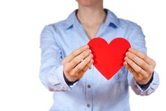 Person holding a heart. A person with blue shirt holding a heart in its hands Royalty Free Stock Images
