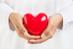 Person holding a heart. Healthy life and valentine's day - person holding a heart symbol Stock Photo