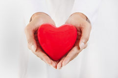 Person holding a heart. Healthy lifestyle concept - person holding a heart Royalty Free Stock Photography