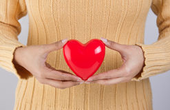 Person holding a heart Royalty Free Stock Images