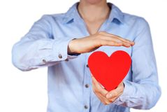 Person holding a heart. A person holds a hand in its hands, isolated Stock Images