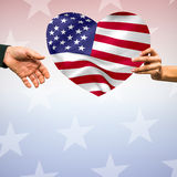Person holding heart shape American flag. Digitally generated image of person holding heart shape American flag Stock Photo