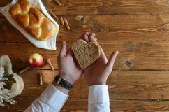 Person Holding Heart Shaped Bread Stock Photography
