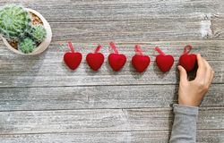 Person holding heart shaped ornaments stock images