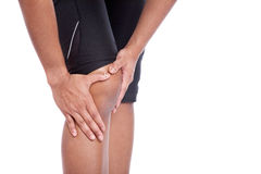 Person holding his or her injured knee Royalty Free Stock Photo