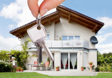 Person Holding The House Key Stock Images