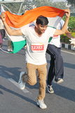 Person holding Indian Flag, Hyderabad 10K Run Event Stock Photography