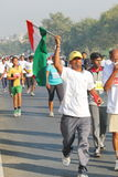 Person holding Indian Flag, Hyderabad 10K Run Event Stock Photos