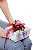 Person holding on knees  present box Royalty Free Stock Photo