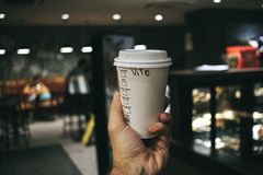 Person Holding Labeled Disposable Cup stock photo