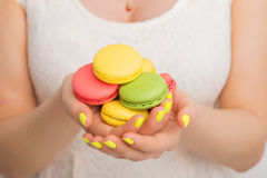 Person holding macaroons in both hands Royalty Free Stock Photo
