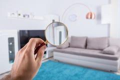 Person Holding Magnifying Glass imagen de archivo libre de regalías