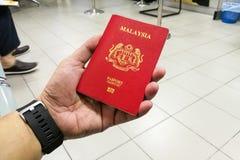 Person holding Malaysia international passport Stock Photography