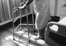 Person Holding Medical Walker Beside White Hospital Bed Royalty Free Stock Image