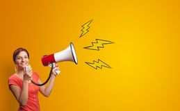 Person holding megaphone. Person shouting lighting bolts with megaphonen stock images